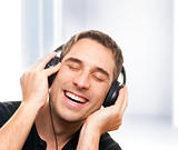 Smiling man listening the music