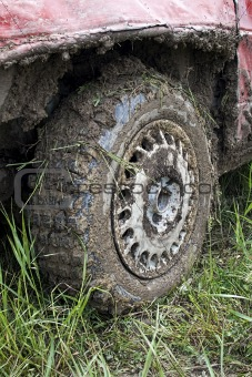 Muddy car tire