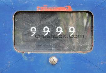 old analog gas pump meter show number 9999