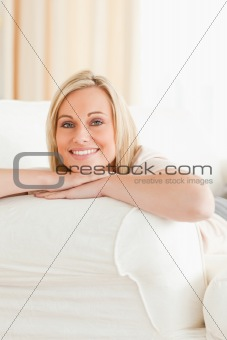 Potrait of a woman lying on her sofa