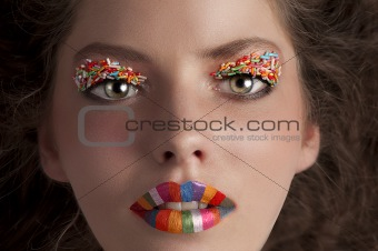 face shot of a young girl wearing candy make up