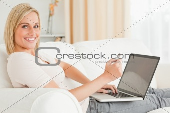 Cute woman paying her bills online