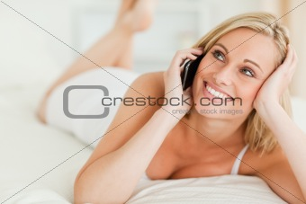 Close up of a woman answering the phone