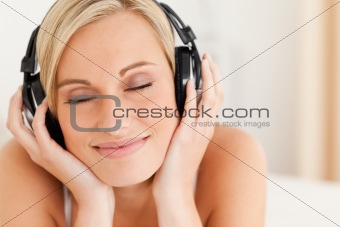 Close up of a delighted woman wearing headphones