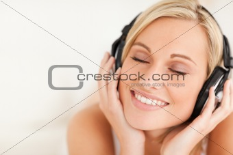 Close up of a serene woman wearing headphones