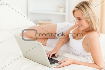 Calm woman using a laptop