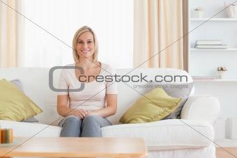 Cute woman sitting on a sofa