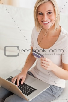 Close up of a smiling woman buying online