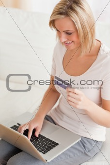 Close up of a charming woman buying online
