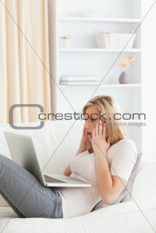Portrait of an amazed woman having trouble her laptop