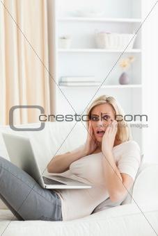 Portrait of woman having trouble her laptop