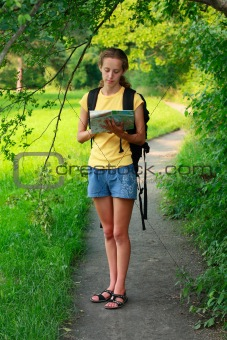 Woman tourist with map in hand