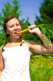 Woman eating Carrot