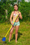 young happy woman raking grass
