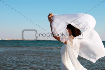 Woman in white at seaside