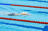 swimmer swimming in a pool
