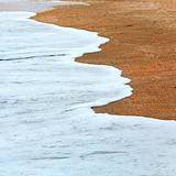 Sea surf foam on coastline sand