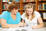 Mother Helps Teen with Homework