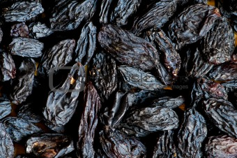 Background made of dark dried raisins