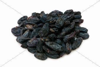 Black raisins isolated on the white background