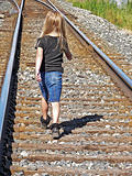 little girl on railroad