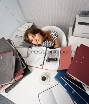 Young woman - financier on office workplace