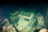 Truck inside the hold of a large shipwreck