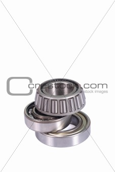 Three different type ball bearings isolated on white background vertical with copyspace