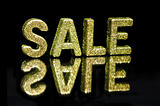 In capital letter written SALE, glitter effect