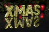 In capital letter written Xmas, glitter effect
