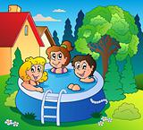 Garden with three kids in pool