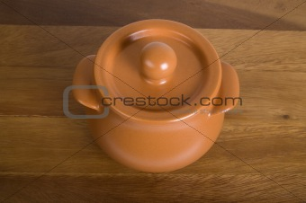 Clay pot on the wooden board