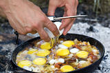 Fried eggs. Cooking on the fire