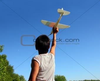 boy running airplane model