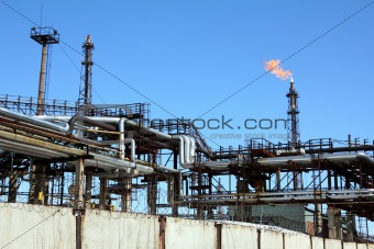 torch is lit on tower refinery