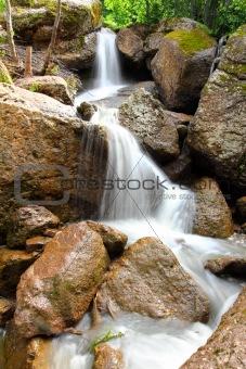 waterfall Kukrauk in summer woods