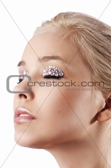 blond girl make up with gem stone