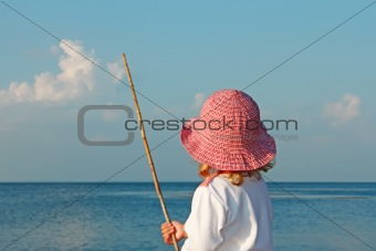 A little girl on the seashore