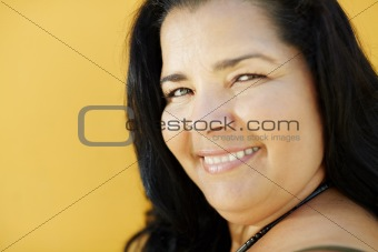 mature hispanic woman smiling at camera