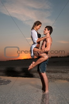 the guy is holding his girlfriend