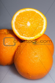 three ripe oranges