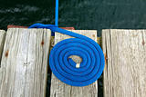 Coiled rope rigging on a jetty.