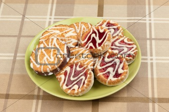 cookies with strawberry jam on a plate