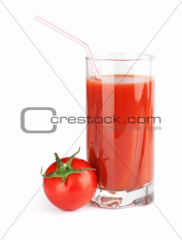 glass of tomato juice and ripe fresh tomato near