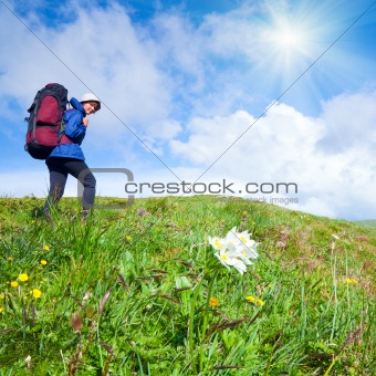 Woman with tourist knapsack on mountain