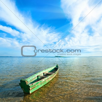 boat on summer lake bank