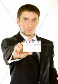 Business man handing a blank business card over white