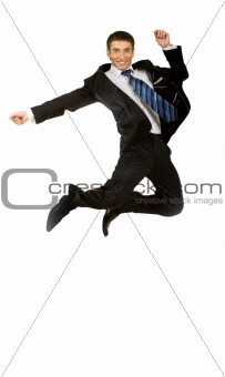 Happy businessman jumping in air against isolated white