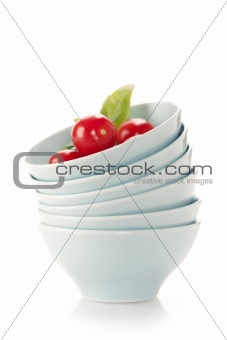 Stack of bowls and tomatoes