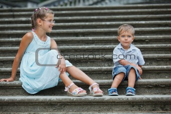 Brother and sister outdoors in city